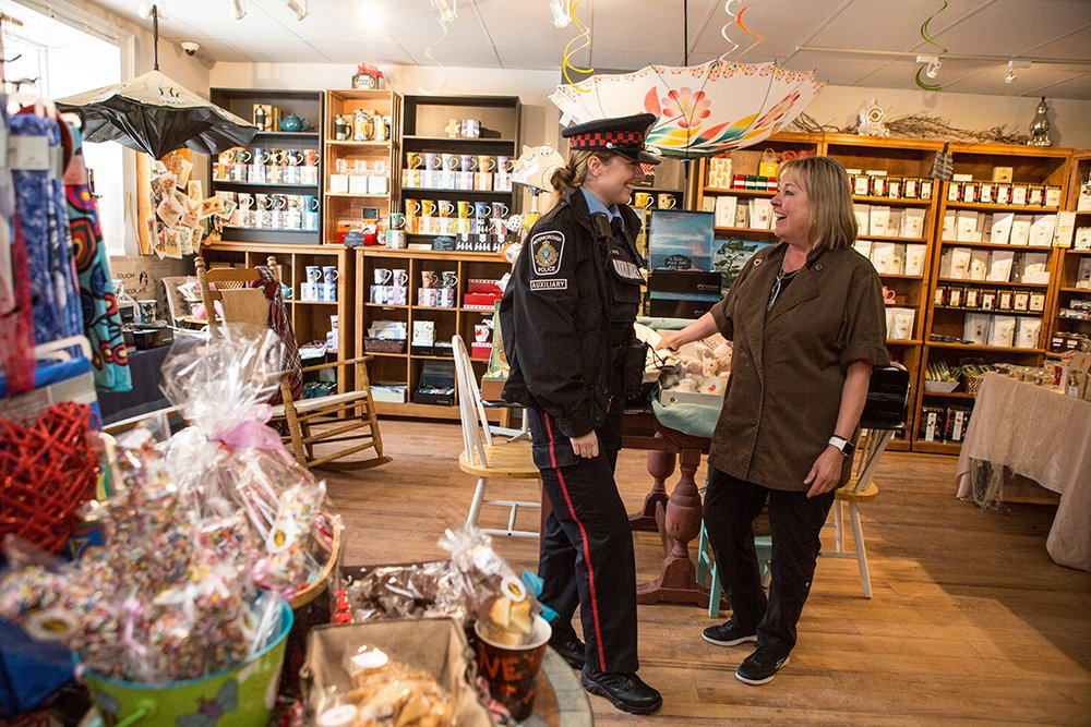 A Peterborough Police officer has a lighthearted conversation with a gift shop store clerk